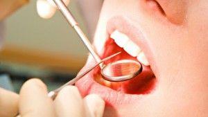 осмотр полости рта