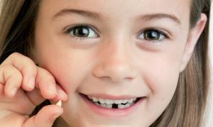 девочка с зубом